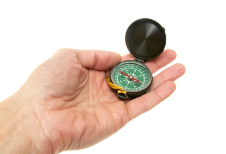 Compass in a mans hand isolated on the white Stock Photo - 8295067