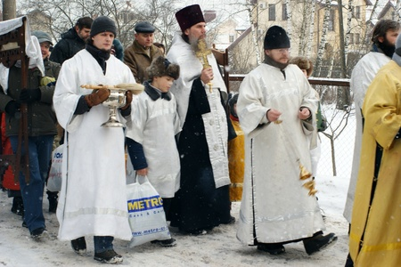 RUSSIA, MOSCOW - JAN 19: Orthodox Christians participate in a christening holiday Solemn consecration of water for a christening holiday  January  19, 2009 in Moscow, Russia