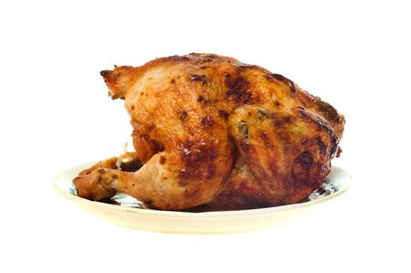 Roast chicken on a plate isolated on the white photo