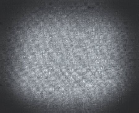 linen texture: Background from black canvas illuminated in  center Stock Photo