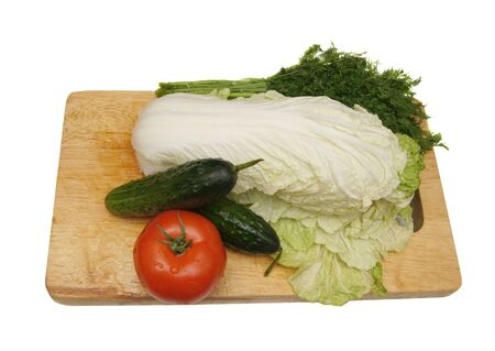 Tomato, salad, cucumbers on a chopping board, isolated on the white Stock Photo - 8671497