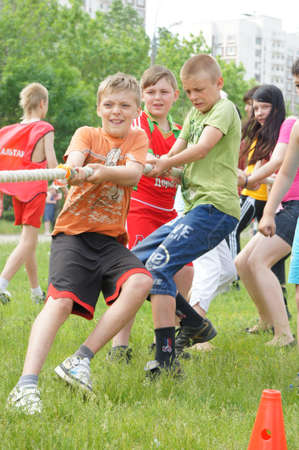 MOSCOW - JUNE 03: Participants of competitions take part in rope pulling in a Sports holiday