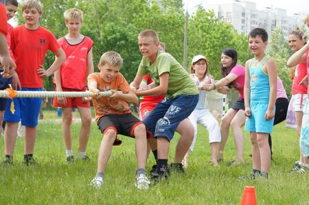 MOSCOW - JUNE 03: Participants of competitions take part in rope pulling in a Sports holiday Starts of hopes on JUNE03, 2011 in Moscow