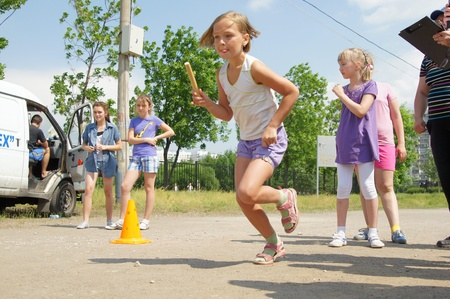 MOSCOW - JUNE 03: Participants of competitions take part in relay race in a Sports holiday Starts of hopes on JUNE03, 2011 in Moscow