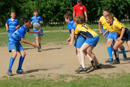MOSCOW,  - JUNE 04: Youthful commands participants compete in Open superiority of area Lianozovo on Rugby football on JUNE04, 2011 in Moscow, Russia