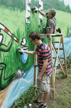 jule: MOSCOW - JULE 13:  Artists paint a wall of a technical construction in area Butyrsky on JULE13, 2011 in Moscow  Editorial