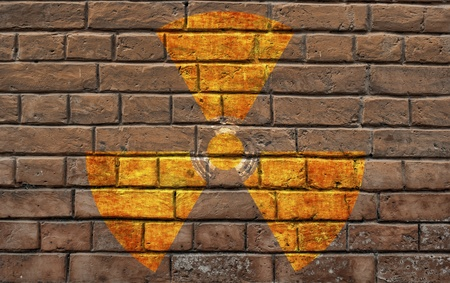 Sign on radioactive danger on an old brick wall Stock Photo - 10030057