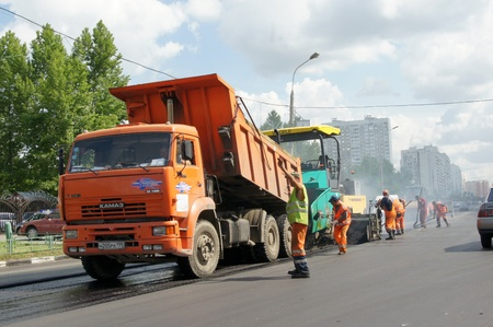 visitors area: MOSCOW - JUNE 22: The brigade of visitors workers repairs road under the program of planned repair in area Marino on JUNE 22, 2011 In 2011 in Moscow will repair 23,5 million in sq.m. of roads