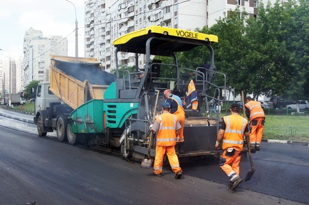 MOSCOW - JUNE 22: The brigade of visitors workers repairs road under the program of planned repair in area Marino on JUNE 22, 2011 In 2011 in Moscow will repair 23,5 million in sq.m. of roads