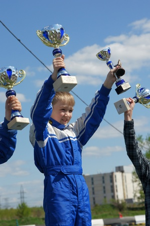 MOSCOW - MAY 09:  Young Racers Rejoice to victory in  go-cart racing devoted to a Victory Day  holiday on MAY 09, 2011 in Moscow