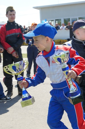 devoted: MOSCOW - MAY 09:  Young Racers Rejoice to victory in  go-cart racing devoted to a Victory Day  holiday on MAY 09, 2011 in Moscow