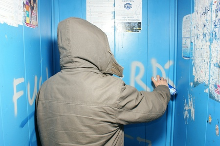 MOSCOW - MART 12: The vandal paints indecent words in the apartment house lift Stock Photo - 10052125