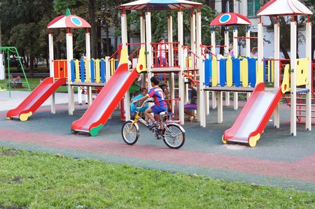 New childrens playground with playing children in Moscow