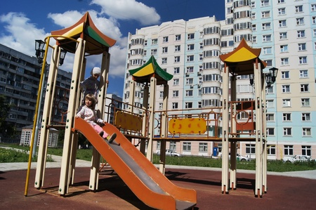 Playing children on a playground against new high apartment houses in Moscow Stock Photo - 10379344