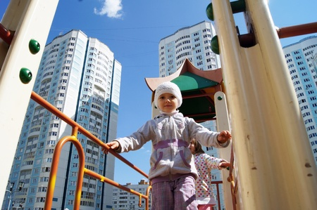 Playing children on a playground against new high apartment houses in Moscow Stock Photo - 10379343