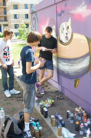 Artists paint a wall of a technical construction in area Butyrsky on JULE02, 2011 in Moscow