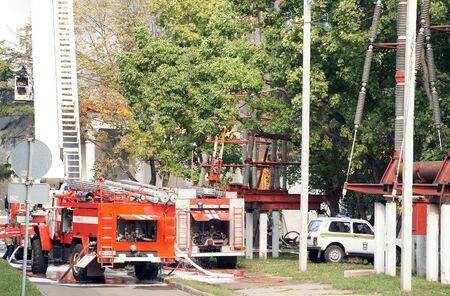 MOSCOW - AUGUST 30:  Firemen extinguish a fire in pavilion Veterinary at the All-Russia Exhibition Centre on AUGUST30, 2011 in Moscow