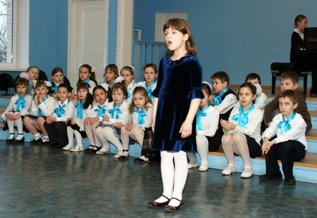 The chorus of girls participates in musical competition at music school in area Butyrsky in Moscow Stock Photo - 10484137
