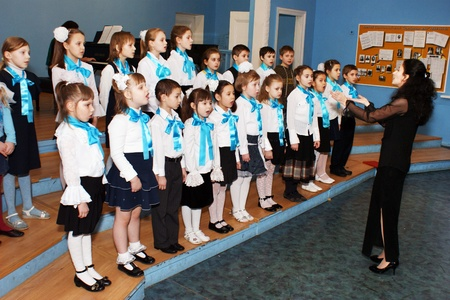 The chorus of girls participates in musical competition at music school in area Butyrsky in Moscow
