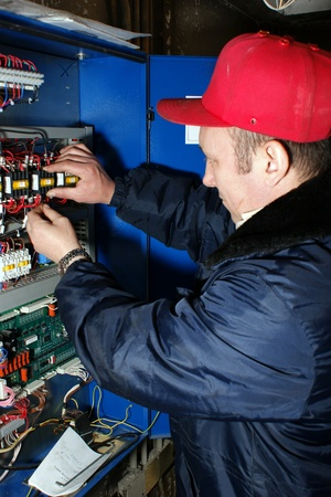 The mechanic makes planned repair of elevators in an apartment house Stock Photo - 10484141