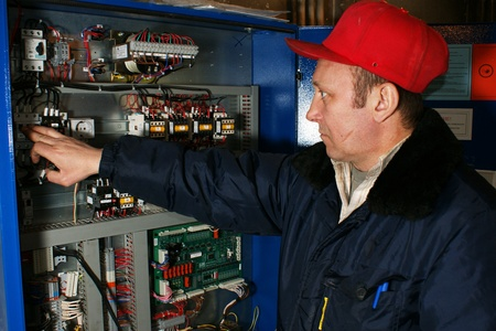 elevator operator: The mechanic makes planned repair of elevators in an apartment house Editorial