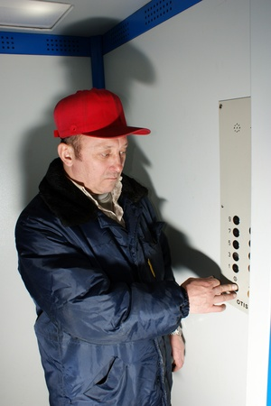 machine operator: The mechanic makes planned repair of elevators in an apartment house Editorial
