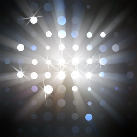 Beams of soft light from round holes and light stars against a dark background