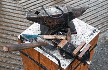 medieval blacksmith: Forge tools on an anvil