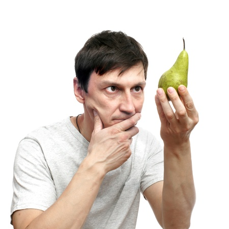 The thoughtful young man with fruit on a white background