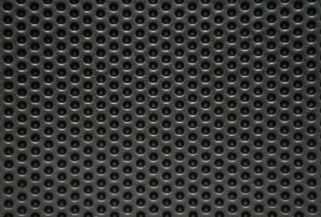 Photo of a natural perforated metal surface photo