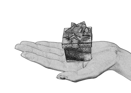 Gift box with a blue bow in a hand isolated on the white photo
