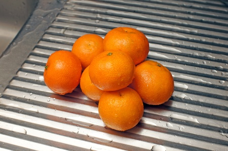 Tangerines on a metal kitchen surface Stock Photo - 11753963