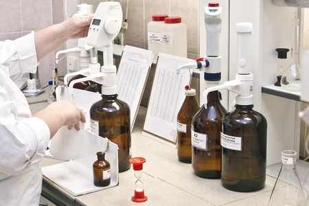 Glass chemical laboratory ware for experiences Stock Photo - 11867622