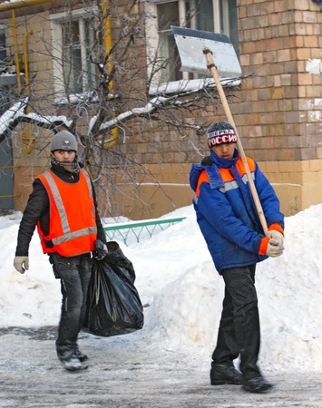 11.01.2010 Moscow, two guest workers clean snow and garbage from city streets