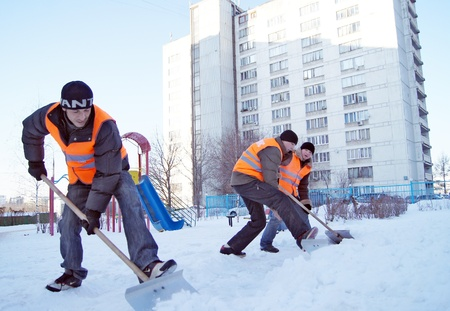 20.01.2012 Moscow. Guest workers clean snow shovels from street.