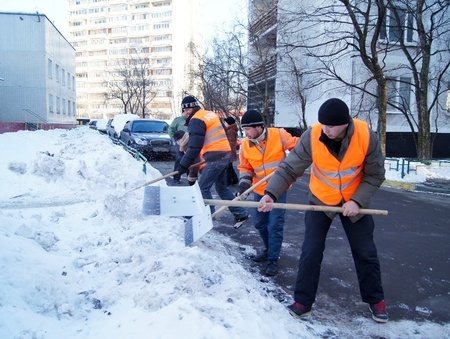 20.01.2012 Moscow. Guest workers clean snow shovels from street. Stock Photo - 12142844