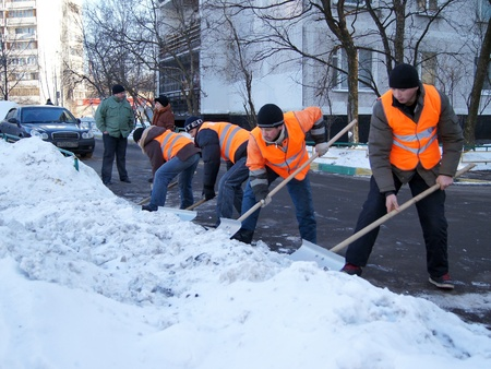 20.01.2012 Moscow. Guest workers clean snow shovels from street. Stock Photo - 12142843