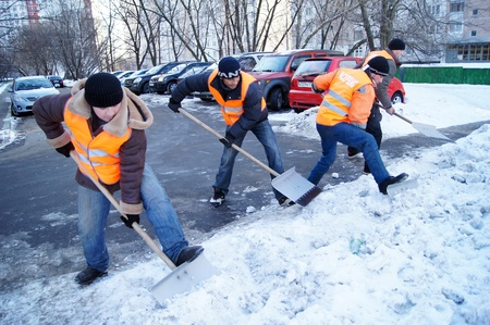 20.01.2012 Moscow. Guest workers clean snow shovels from street. Stock Photo - 12142845