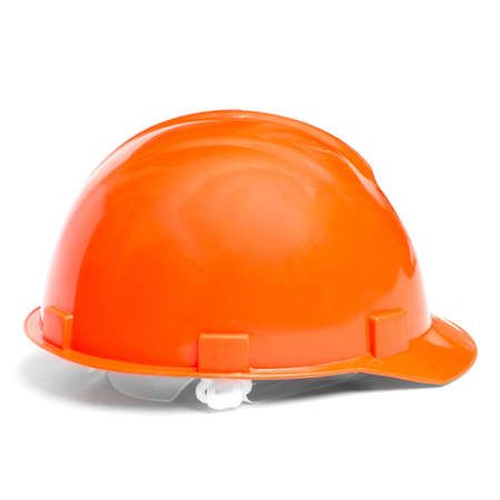 Building protective helmet on white background photo