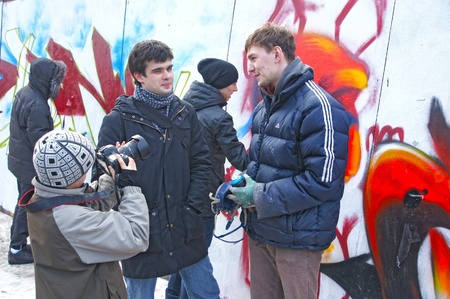 MOSCOW - MARCH 17:  Participants of competition draw on a wall of graffiti at the first stage of city festival Graffiti jam. on MARCH 17, 2012 in Moscow, Design factory Bottle.