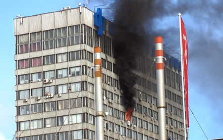 MOSCOW - MARCH 17:  Fire in many-storeyed office building. on MARCH 17, 2012 in Moscow, Novodmitrovskaya street.