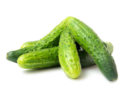 fresh green cucumbers, isolated on the white Stock Photo - 12849838