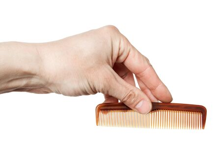 plastic comb: hairbrush in a hand, it is isolated on the white Stock Photo