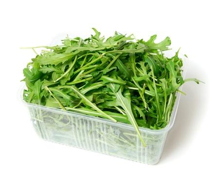 green arugula, isolatedon the white photo