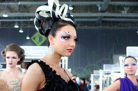The XV Championship of Moscow on hairdressers art, decorative cosmetics, modeling and design of nails Stock Photo - 13021904