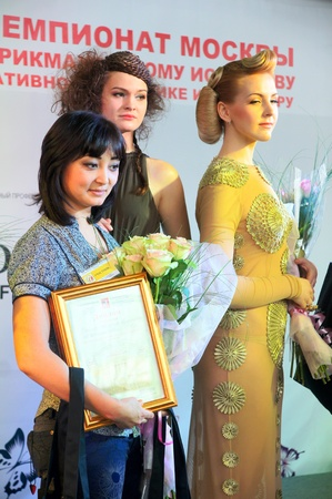 The XV Championship of Moscow on hairdressers art, decorative cosmetics, modeling and design of nails Stock Photo - 13021922