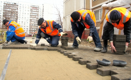 12_04_2012 Moscow, Russia  The workers paves a stone path Stock Photo - 24244952