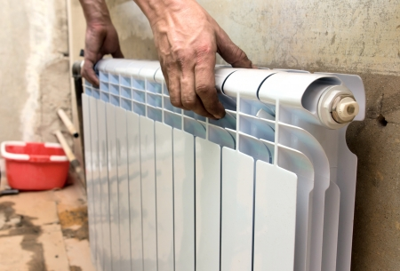 real photo of installation of a radiator Stock Photo