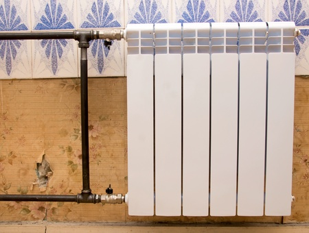 real photo of installation of a radiator Stock Photo - 13330752