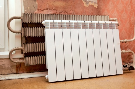 real photo of installation of a radiator photo